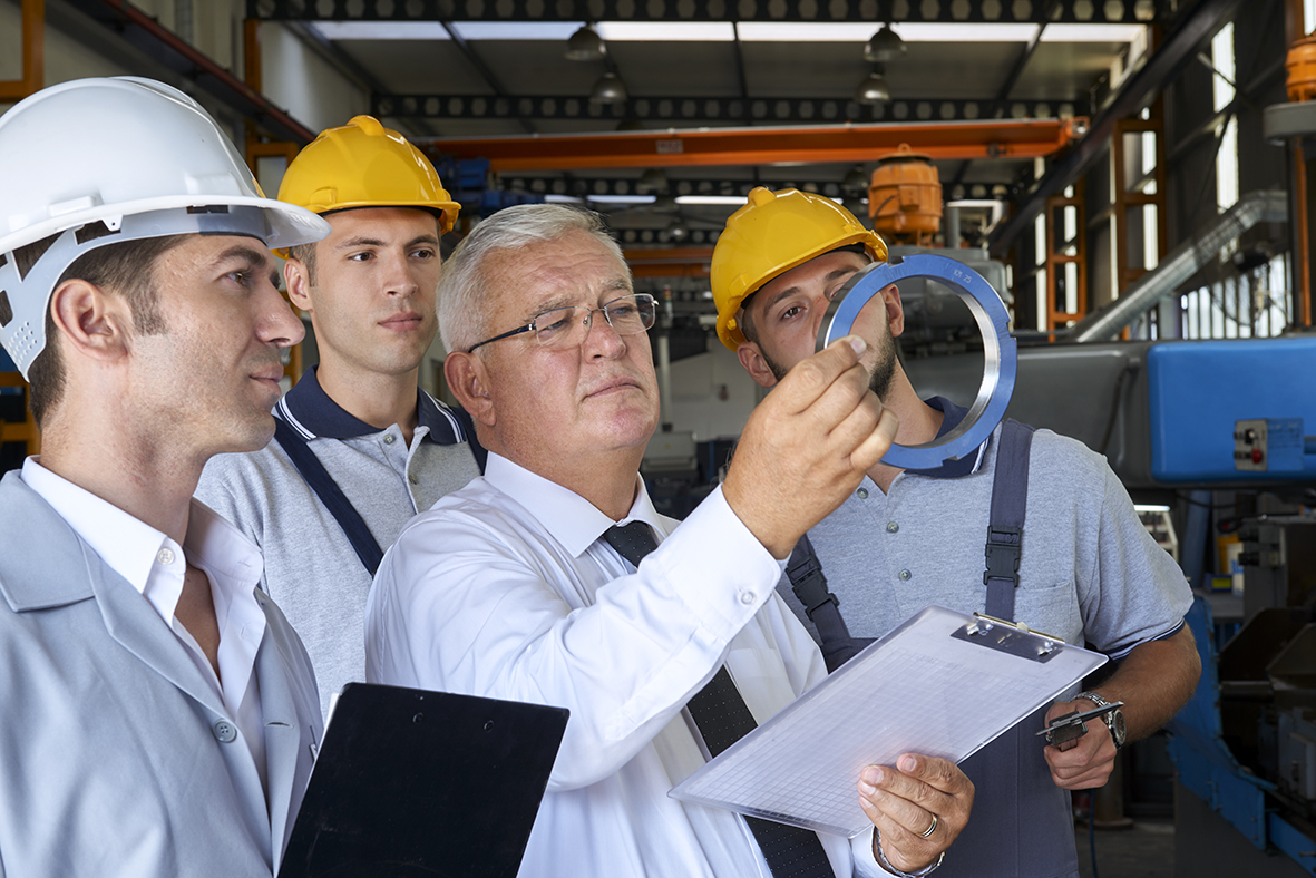 Supervisor and factory workers
